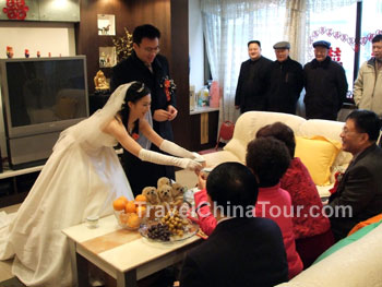 Offering tea at Chinese wedding.